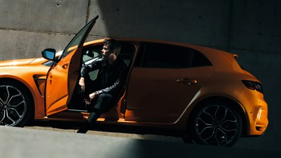 Renault MEGANE RS - man getting out of his car with a sporty look